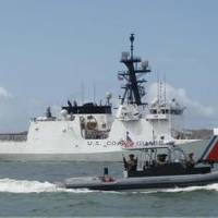 A patrol boat manned by members of Port Security Unit 311deployed to Joint Task Force-Guantanamo Bay, Cuba, escorts the Coast Guard Cutter Bertholf as it sails into Naval Base Guantanamo Bay, June 20, 2013. Bertolf pulled into the naval base during their recent deployment. (U.S. Coast Guard photo by Petty Officer 1st Class Matthew Roache)