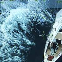 A sailboat became disabled after it was caught in rough weather 345 miles from North Carolina. (Photo: U.S. Coast Guard)