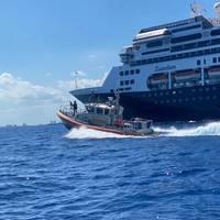 A U.S. Coast Guard Station Ft. Lauderdale boat crew escorts the cruise ship Zaandam to Port Everglades April 2, 2020. (U.S. Coast Guard photo)
