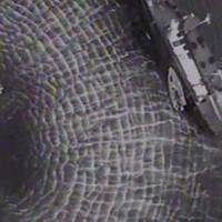 A USCG helicopter crew hoists an ailing mariner from the fishing vessel Western Profit near Sitka, Alaska. After safely hoisting the injured man, he was brought to a higher level of medical care in Sitka. (Screenshot of USCG_ video by Air Station Sitka.