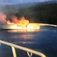 A USCG image of local responders fighting the fire on board the Conception.