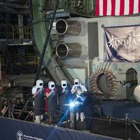 A welder carves the initials of ship's sponsor Diane Donald on a metal plate during the keel laying ceremony for the future Virginia-class attack submarine Indiana (SSN 789). (U.S. Navy photo courtesy of Huntington Ingalls Industries by Ricky Thompson)