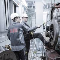 ABB Turbocharging service engineers  at work carrying out maintenance on a containership (Photo: ABB)