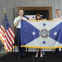 Adm. Zukunft (right), presents the new flag of the vice commandant of the Coast Guard to Adm. Charles at the conclusion of a ceremony at the Douglas Munro Coast Guard Headquarters Building in Washington, D.C., June 1, 2016. (U.S. Coast Guard photo by Kyle Niemi)