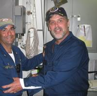 Maersk-Alabama Capt. Richard Phillips, right, stands alongside Cmdr. Frank Castellano, commanding officer of USS Bainbridge after being rescued by U.S Naval Forces off the coast of Somalia. (Official U.S. Navy photo)