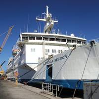 Africa Mercy alongside at a repair berth in Astican Shipyard, Las Palmas, Gran Canaria for brief annual upkeep period of repairs and modernization.  (Photo credit: © Mercy Ships/Ann Berry)