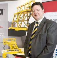 Alistair Dornan, President and Chief Executive Officer of Sigma Offshore, next to a scale model of the company's SMS innovation (Photo: Sigma Offshore).