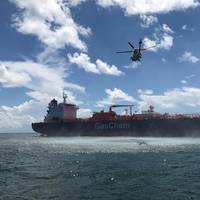 An MH-60 Jayhawk helicopter from Air Station Clearwater approaches the 550-foot tanker Gaschem Stade, 13 miles west of Egmont Key, Florida, Monday, Aug. 14, 2017. The Jayhawk air crew medevaced a 55-year-old man from the tanker after he suffered heart attack like symptoms. (U.S. Coast Guard photo by Gage Hunt)