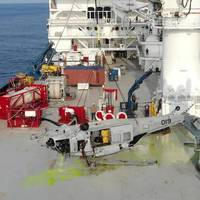 An MH-60S on deck of contracted salvage vessel off the coast of Yokosuka, Japan on March 18, 2021, having just been pulled from the depth of 19,075 ft by NAVSEA Supervisor of Salvage and Diving, (SUPSALV) at the request of the Navy Safety Center to facilitate accident investigation. This depth, a SUPSALV record, achieved using the ROV CURV 21 (painted yellow in background), deep ocean lift line and heave compensated Fly Away Dive System (red equipment behind helicopter). (Photo: U.S. Navy)