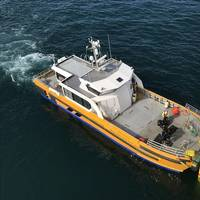 An offshore wind crew transfer vessel servicing an offshore wind farm - Credit: ORE Catapult