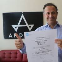 Ardent CEO, Peter Pietka displays the ISO 9001:2015 certificate from Lloyd's Register Quality Assurance. (Photo: Ardent)