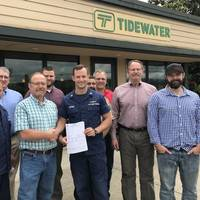 Back row (l-r): Chris Springer, District 13 USCG; Bill Collins, Tidewater EHS&S Director; Josh Jarman, Tidewater Quality & Compliance Manager; Marc Schwartz, Tidewater Maintenance & Engineering Manager; Craig Nelson, Tidewater Vessel Operations Manager; Bruce Reed, Tidewater VP & COO; Josh Nichols, Tidewater Captain & Assistant Port Captain. Front row (l-r): Austin Murai, MSTC USCG; Brian Fletcher, Tidewater Port Captain; Jeff Deronde, MST1 USCG (Photo: Tidewater)