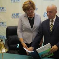 Betsy Benac, chairwoman of the Manatee County Port Authority, left, looks over the 2016 Port Manatee Master Plan Update with Carlos Buqueras, the port's executive director. (Photo: Port Manatee)