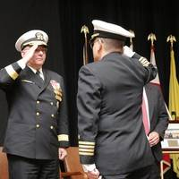 Capt. Howard Goldman , right, reports that he has assumed command of Naval Undersea Warfare Center (NUWC) Division Newport to Rear Adm. Michael Jabaley, commander of NUWC (center), as the former commander of NUWC Newport, Capt. Todd Cramer,  looks on.