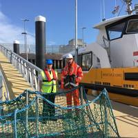 Captain Jeff Gaskin, Aberdeen Harbour Master, and Adam Ezzamel, EOWDC Project Director, Vattenfall, on the new pontoon Photo Aberdeen Harbor )