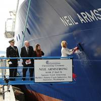 Carol Armstrong, sponsor for the R/V Neil Armstrong , breaks a bottle across bow during a christening ceremony at Dakota Creek Industries, Inc., shipyard in Anacortes, Wash. Joining Carol on the platform are Rear Adm. Matthew Klunder, left, chief of naval research, Dick Nelson, president, Dakota Creek Industries, Inc., and Kali Armstrong, granddaughter of the late astronaut. (U.S. Navy photo by John F. Williams)