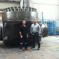 Wojciech Zmudzinski, Chief Pipeline Engineer for McDermott (right) with an INPEX Ichthys Project representative during a valve manufacturing inspection at a factory in Italy.