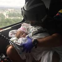 Coast Guard Aircrew Assists Infant During the Aftermath of Hurricane Harvey (U.S. Coast Guard photo by Chase Redditt)