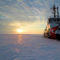 Coast Guard Cutter Bristol Bay sits in the middle of Lake Erie as its crew takes ice liberty during a short break from ice breaking duties as part of Operation Coal Shovel, March 2015. The crew of the Bristol Bay, along with the Canadian Coast Guard Ship Griffon, escorted the motor vessel Algoma Hansa through a frozen Lake Erie. (U.S. Coast Guard photo by Nick Gould)