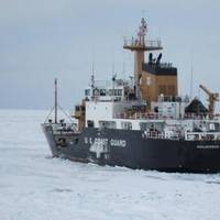 Coast Guard Cutter Hollyhock continues breaking ice as it transits to St. Ignace, Mich., to undergo a full damage assessment. (U.S. Coast Guard photo)