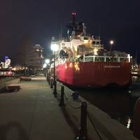 "Coast Guard cutter Mackinaw is moored at Navy Pier in Chicago. Loaded with 1,200 Christmas trees, Mackinaw arrived in Chicago to serve as this year's ""Christmas Ship"". (U.S. Coast Guard photo by Brian Hinton)"