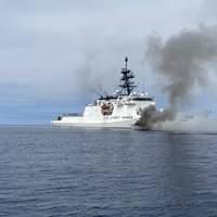 Coast Guard Cutter Munro crewmembers work with Coast Guard Cutters Haddock and Benjamin Bottoms to extinguish a vessel fire off the coast of San Diego, July 15, 2021. The vessel left the Oceanside harbor heading towards Carlsbad when it was seen on fire. (U.S. Coast Guard courtesy photo)