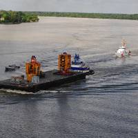 Coast Guard, New Orleans Port Authority and Homeland Security units provide an escort as the blowout preventer of the Deepwater Horizon is transported on the Mississippi River into New Orleans, Sept. 11, 2010. The blowout preventer will be used to help the joint BOEM/USCG investigation determine the circumstances surrounding the explosion, fire, pollution, and sinking of the Mobile Offshore Drilling Unit Deepwater Horizon. U.S. Coast Guard photo by Petty Officer 3rd Class Stephen Lehmann