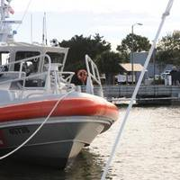 Coast Guard Station Tybee Island Ga.'s new 45-foot Response Boat-Medium sits at the station's pier. Coast Guardsmen from Sector Charleston, S.C., along with members of the Coast Guard Auxiliary, the mayor of Savannah, Ga., the pro tempore mayor of Tybee and representatives from local agencies, attended a ceremony recognizing the arrival of the new boat to the unit. (U.S. Coast Guard photo by Petty Officer 3rd Class Anthony L. Soto)