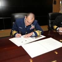 Coast Guard Vice Adm. Charles Michel, deputy commandant for operations, and NOAA Vice Adm. Michael Devany, deputy under secretary for operations, sign the Fleet Plan Agreement letter of promulgation at U.S. Coast Guard Headquarters, Washington, D.C Oct. 8, 2014 (Photo: NOAA)