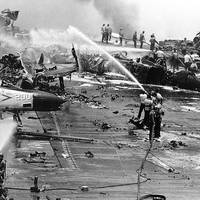 Crew members fight a series of fires and explosions on the carrier USS Forrestal's after flight deck, in the Gulf of Tonkin, 29 July 1967. The conflagration took place as heavily-armed and fueled aircraft were being prepared for combat missions over North Vietnam. (Official U.S. Navy Photograph.)