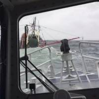 Crewmembers from Coast Guard Station New London aboard a 45-foot Response Boat-Medium approach a 55-foot fishing vessel taking on water near Fishers Island, New York, Sunday March 10, 2019. The individuals were picked up within one minute of abandoning ship. (Photo by Petty Officer 3rd Class Steven Strohmaier, courtesy of Station New London)
