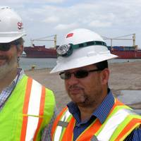 Crowley's Bleu Hilburn and Tony Ortiz in front of the company's chartered ship Vega (Photo courtesy of Crowley Maritime Corp.)