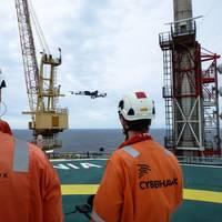 Cyberhawk team operating drones offshore Photo Cyberhawk