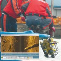 Daekee Marine's team deploys the TOV-1 towed video (Inset) – Side scan image of harbor bottom littered with tires, pipes, and debris.