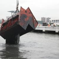 Donjon Marine dredges New York Harbor for the return and  re-entry of the USS Intrepid, a museum and educational center.
