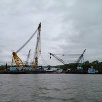 Donjon Marine's 1000-ton capacity Derrick Barge Chesapeake 1000 works to refloat the 277-foot Ex-Staten Island NY Car Ferry Gov. Herbert H. Lehman, which sank in the Hudson River while in layup in Newburg, NY.