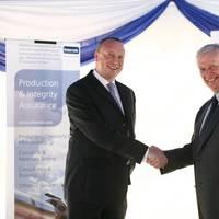 Dr. Tom Whitfield, manager of E&P for South East Asia at Intertek with Raymond Pirie, vice president of Intertek's global upstream business at the official opening event of the new regional center