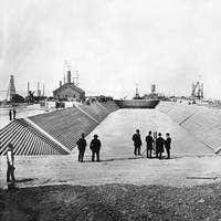 Dry Dock 1 at Newport News Shipbuilding is flooded prior to the official opening celebration of the shipyard's first dry dock on April 24, 1889.  The Puritan-class monitor USS Puritan waits beyond the dry dock's gate to enter. (Photo: HII)