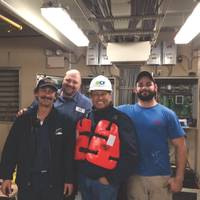 Ed Grimm, (second from left) CEO, Southern Towing Company during a crew visit.