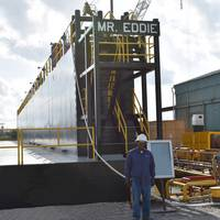 "Eddie Barnes, Jr., namesake for new dry-dock at Bollinger Quick Repair, Harvey, La. stands in front of the ""Mr. Eddie"". (Photo: Bollinger Shipyards)"