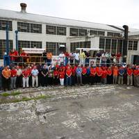 Ellicott employees gather at the company's Baltimore plant following a celebratory lunch in front of a Series 370 Dragon dredger (Photo: Ellicott Dredges)