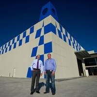 EnerMech finance director Michael Buchan (left) with Vicon Services managing director Niall Conlon, outside Vicon's new Perth base which is under construction.