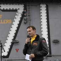 File photo: Capt. Brett Crozier, commanding officer of the aircraft carrier USS Theodore Roosevelt (CVN 71), addresses the crew during an all-hands call on the ship's flight deck in November 2019 (U.S. Navy photo by Nicholas Huynh)