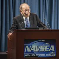 File photo: Sarkis Tatigian delivers remarks during a celebration of his 75 years of federal service at the Washington Navy Yard in 2017. (U.S. Navy photo by Jackie Hart)