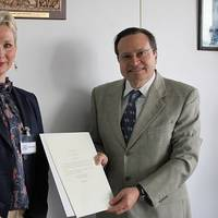 First Secretary Kristin Stockman of the Royal Norwegian Embassy to the United Kingdom, hands over Norway's instrument of accession to the  Hong Kong International Convention for the Safe and Environmentally Sound Recycling of Ships, 2009, to Mr. Gaetano Librando, Head, Legal  Affairs Office, Senior Deputy Director, Legal Affairs and External Relations Division, IMO