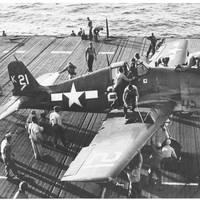 Flight Deck Crew Swarm Over an F6F Hellcat - July 1944. (Photo: U.S. Navy's National Museum of Naval Aviation, Pensacola, Fla.)