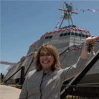 Former U.S. Rep. Gabrielle Giffords waves to a crowd in front of the littoral combat ship, USS Gabrielle Giffords (LCS 10), during the ship's christening ceremony on June 13, 2015. US Navy photo.