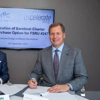 From left to right, MGM owner John Angelicoussis and Excelerate Managing Director and President Steven Kobos sign the agreement. Photo: Excelerate Energy