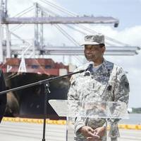 GPA Executive Director Curtis Foltz, left, and Lt. General Thomas Bostick, commander of the USACE, give an update on the Savannah Harbor Expansion Project as cranes work a vessel, Thursday, May 28, 2015, at the Garden City Terminal near Savannah, Ga. (Photo: Georgia Ports Authority/Stephen B. Morton)