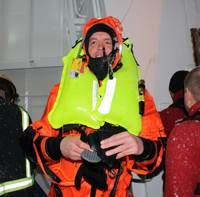 Gudmunder Bragason of Sónar emerges from Rejkavik harbour covered in ice after the successful Kru lifejacket/ R10 demonstration.